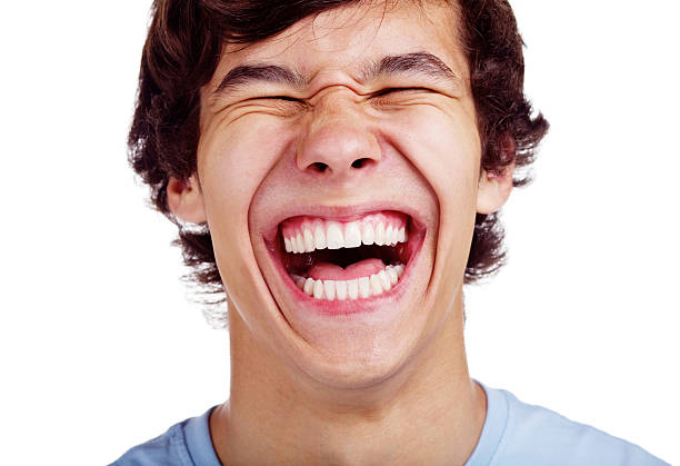 Happy teenage laugh closeup Close up portrait of loudly laughing young man isolated on white background mouth open stock pictures, royalty-free photos & images