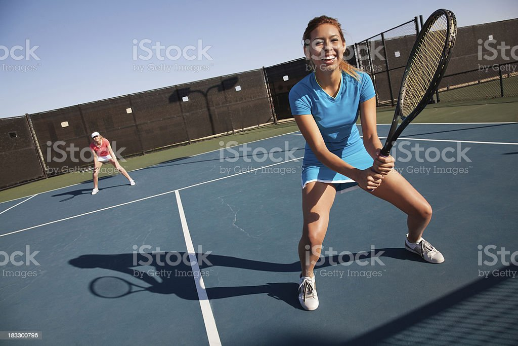 Happy Teenage Tennis Player Partners Playing a Match royalty-free stock photo