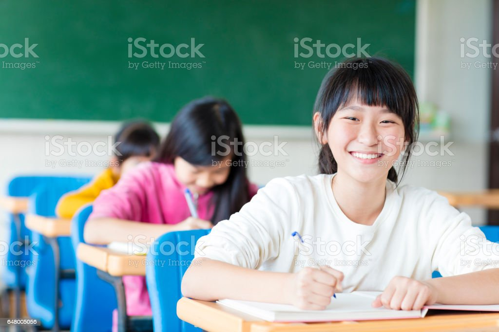 happy teenager girl learning in the classroom royalty-free stock photo