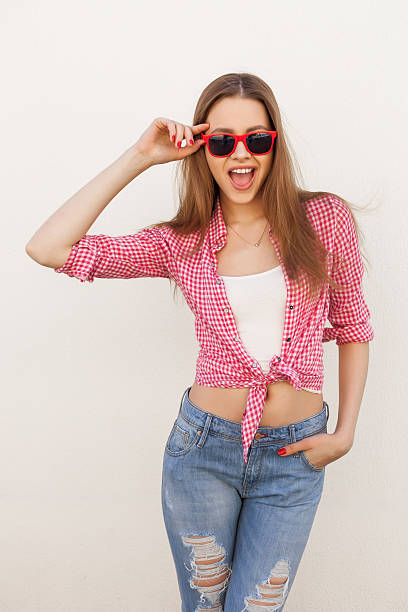 Happy teenager girl posing and smiling stock photo