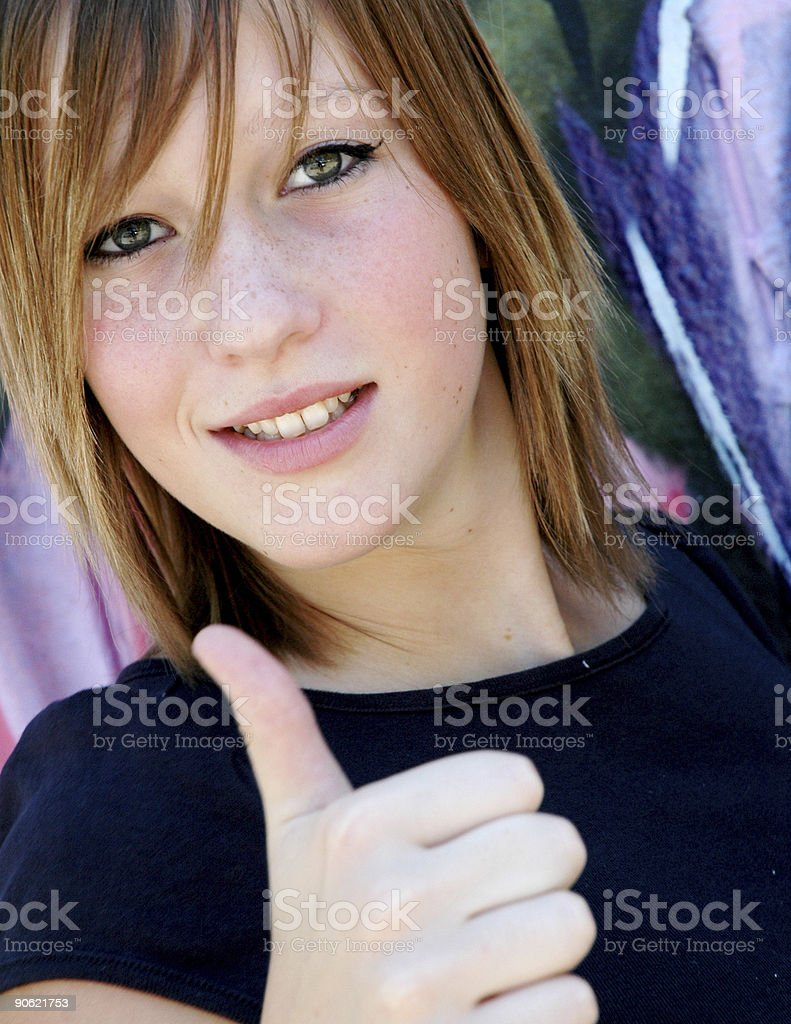 Happy teenager giving thumbs up royalty-free stock photo