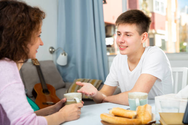 Happy teenager talking to mom stock photo