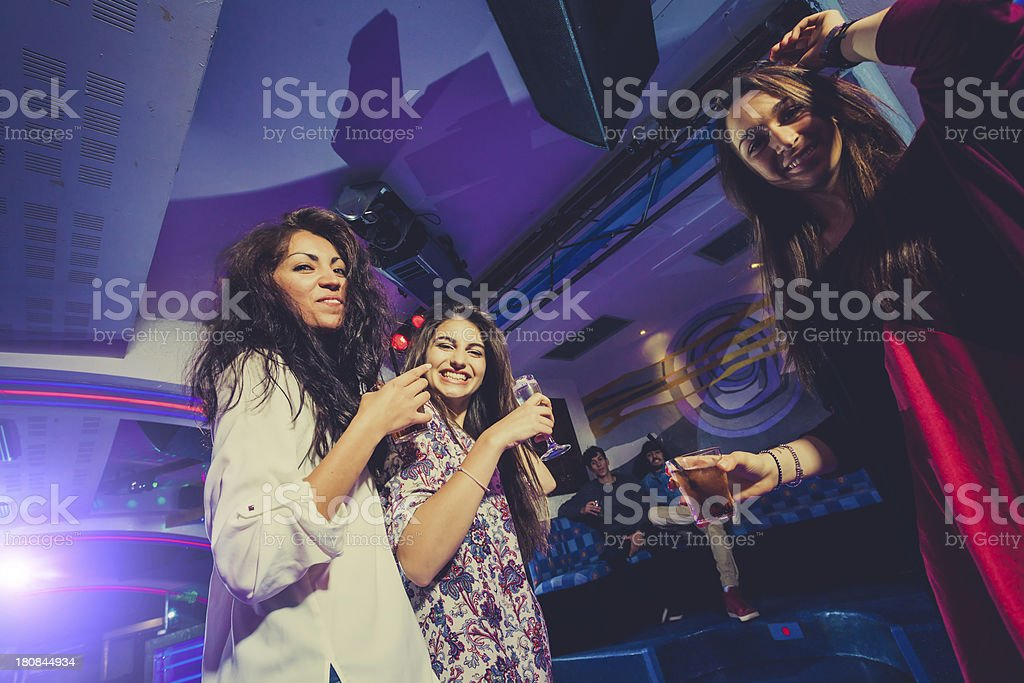 Happy Teenagers Girls Dancing at Discoteque with Friends, Nightlife stock photo