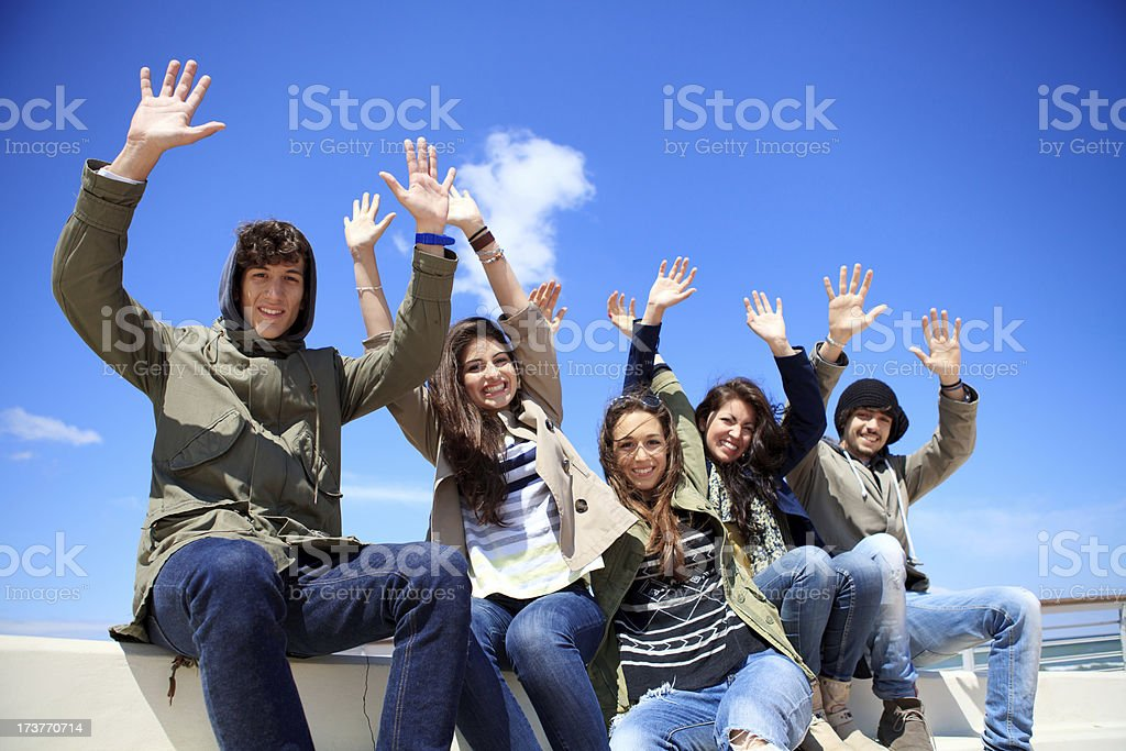Happy teenagers with hands up royalty-free stock photo