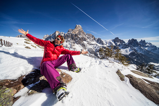 Happy telemark ski girl on the top of the mountain