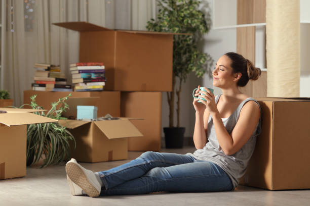 Happy tenant moving home resting breathing fresh air stock photo