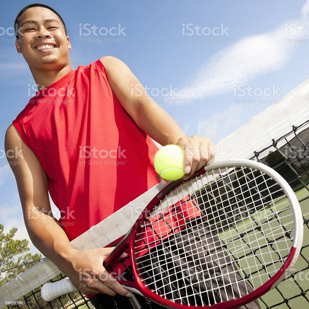 Happy Tennis Player at Net With Racquet royalty-free stock photo