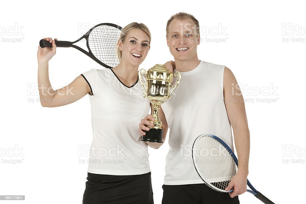 Happy tennis players holding a trophy royalty-free stock photo