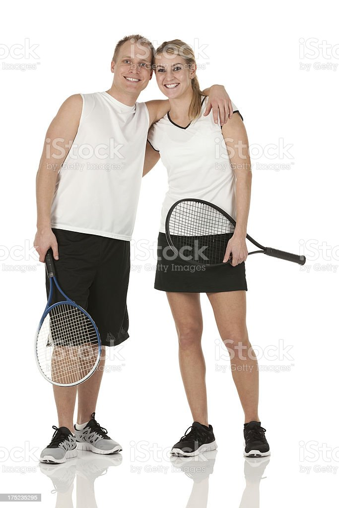 Happy tennis players with rackets royalty-free stock photo