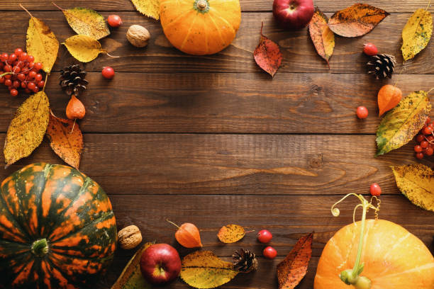 happy thanksgiving concept. autumn composition with ripe orange pumpkins, fallen leaves, dry flowers on rustic wooden table. flat lay, top view, copy space. - autumn stock pictures, royalty-free photos & images