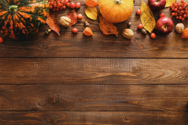 happy thanksgiving concept. autumn composition with ripe orange pumpkins, fallen leaves, dry flowers on rustic wooden table. flat lay, top view, copy space. - thanksgiving стоковые фото и изображения