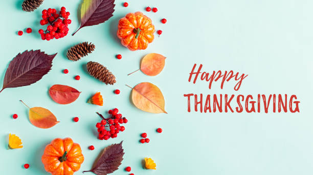 happy thanksgiving greeting card with leaves, pumpkins, rowan berries on mint background. fall, thanksgiving concept. - thanksgiving стоковые фото и изображения