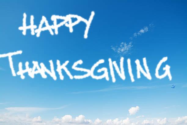 happy thanksgiving in the sky - schrift am himmel stock-fotos und bilder