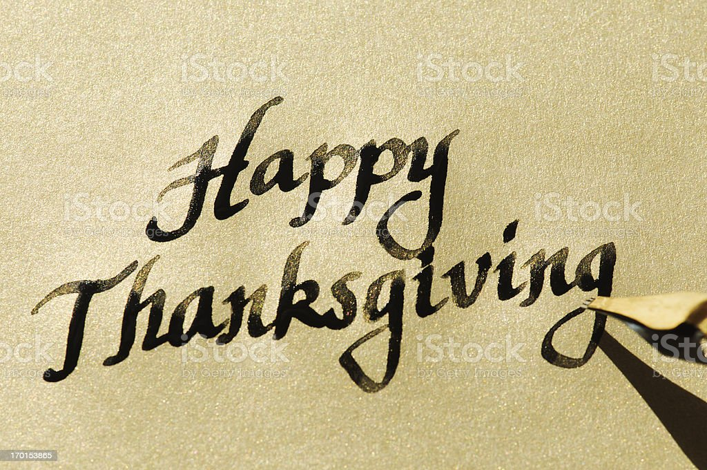 Happy Thanksgiving Message in Calligraphy on Gold royalty-free stock photo