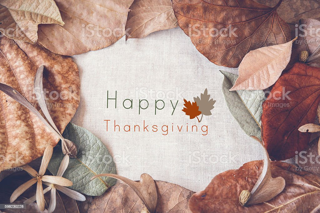 Happy thanksgiving on Autumn leaves toning background foto royalty-free