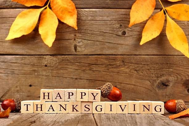 Happy Thanksgiving Wooden Blocks Against Rustic Wood With Autumn Leaves Pictures Images And Stock Photos