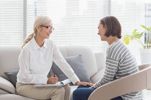 Happy therapist with patient stock photo