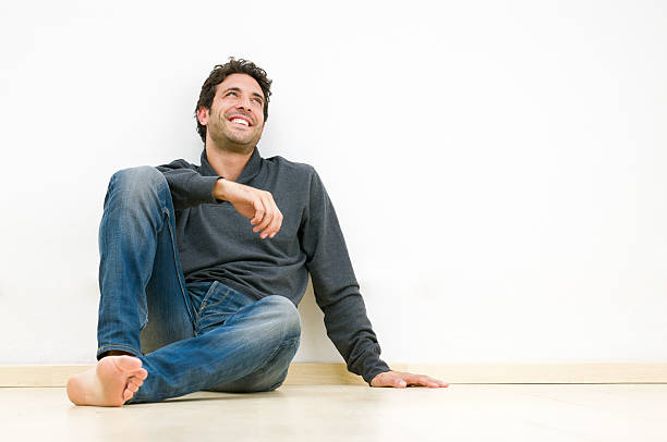 happy thinking guy - sitting on floor stock photos and pictures