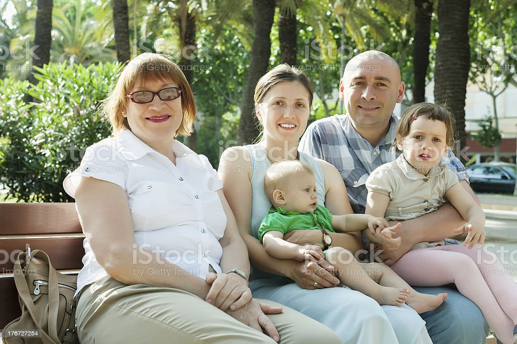 happy three generations family sitting in  street royalty-free stock photo