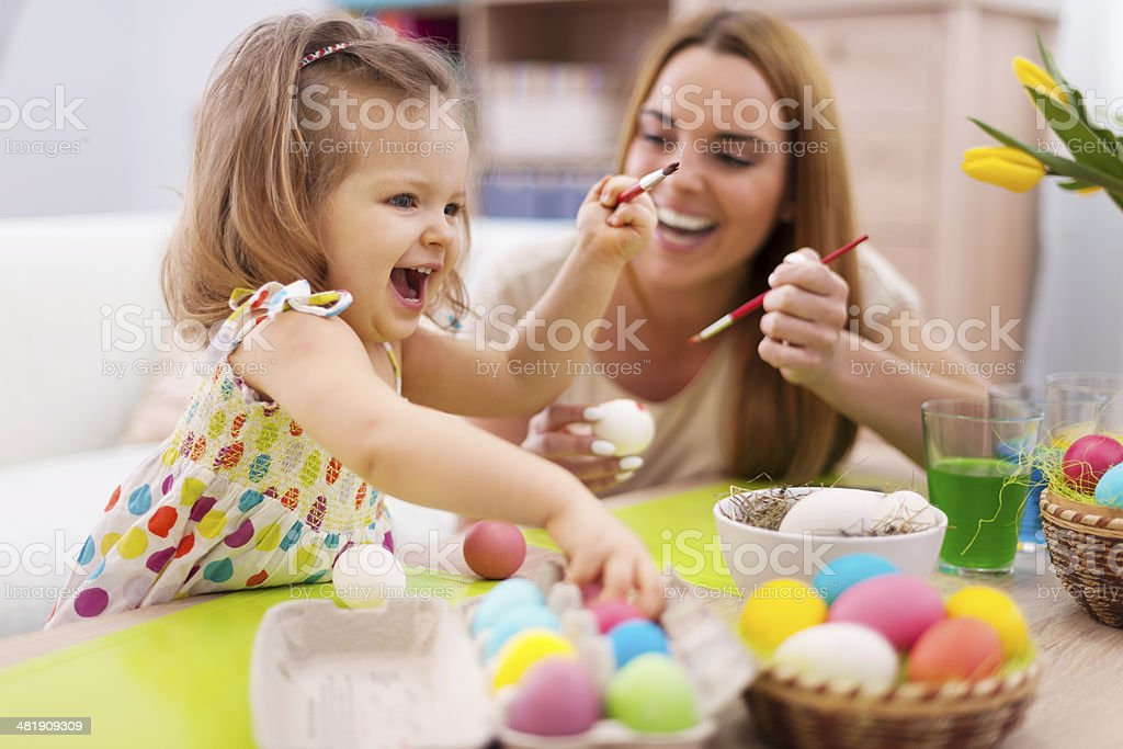 Happy time while painting easter eggs stock photo
