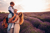 Photo of happy little family enjoying together at the lavender field