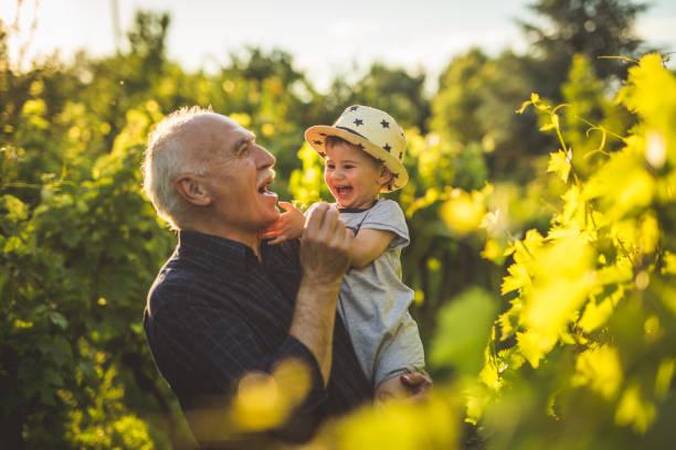 Happy times with grandpa stock photo
