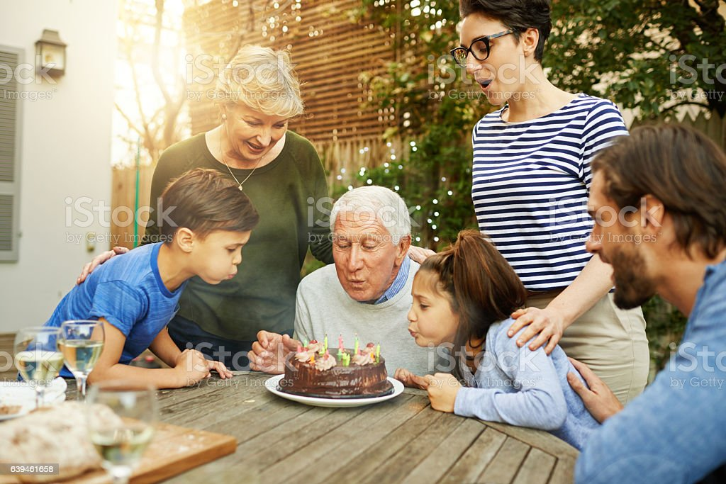 Happy to help grandpa with the candles stock photo