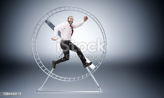 caucasian businessman in hamster wheele is happy to work hard