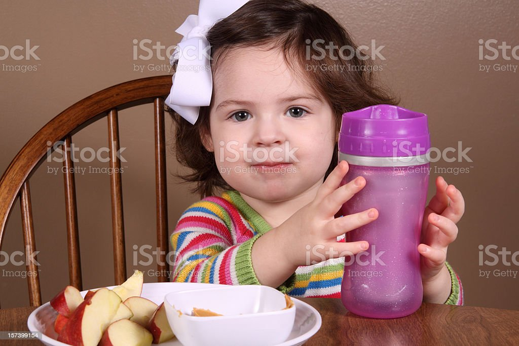 Happy Toddler at Snacktime stock photo