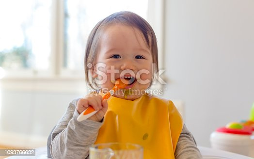 istock Happy toddler boy eating a meal 1093766632