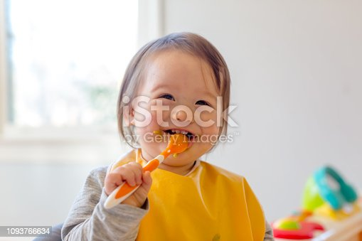 istock Happy toddler boy eating a meal 1093766634