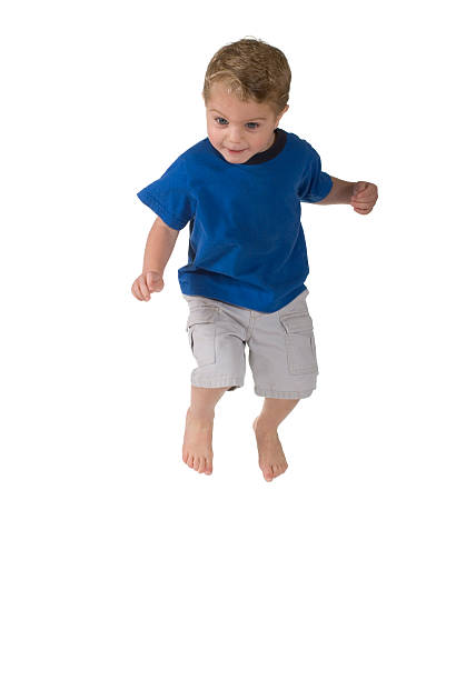 Happy Toddler Boy Jumping stock photo