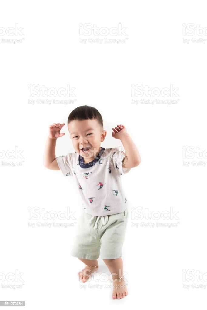 Happy toddler boy jumpping with smile face say Huray on white background - Royalty-free Asia Stock Photo