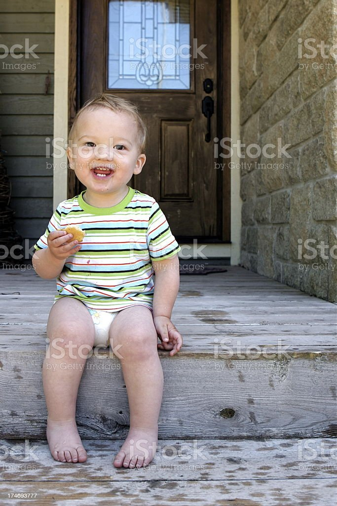 Happy Toddler Eating a Cookie royalty-free stock photo