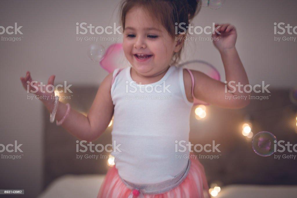 Happy toddler girl stock photo