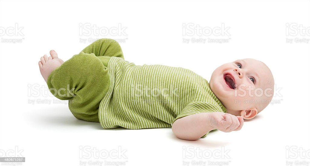 happy toddler laying on back stock photo