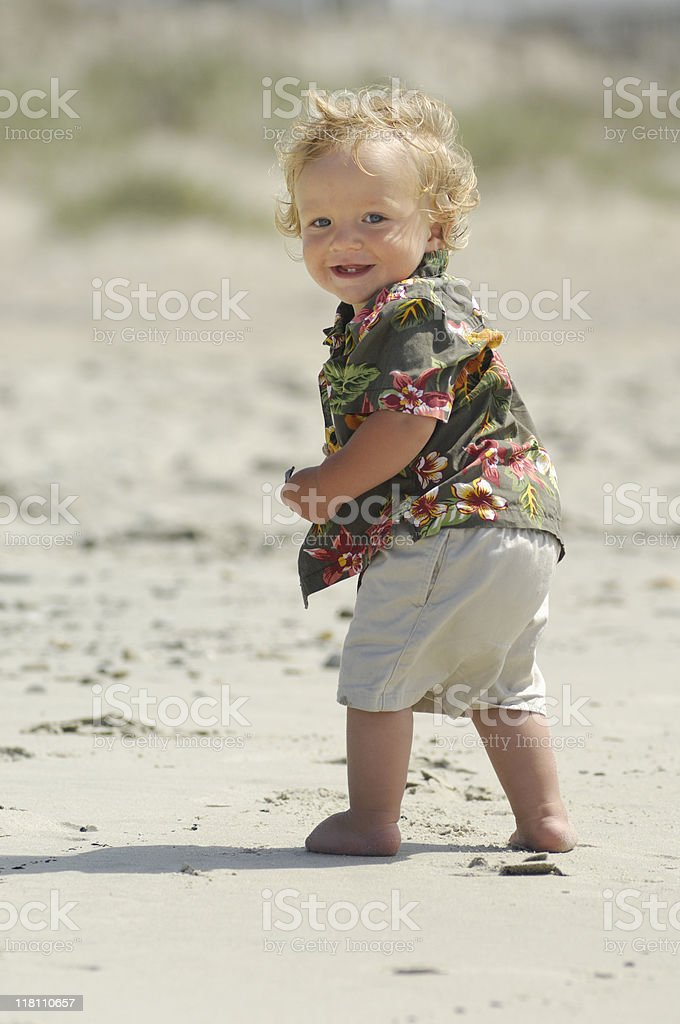 Happy toddler on the beach royalty-free stock photo