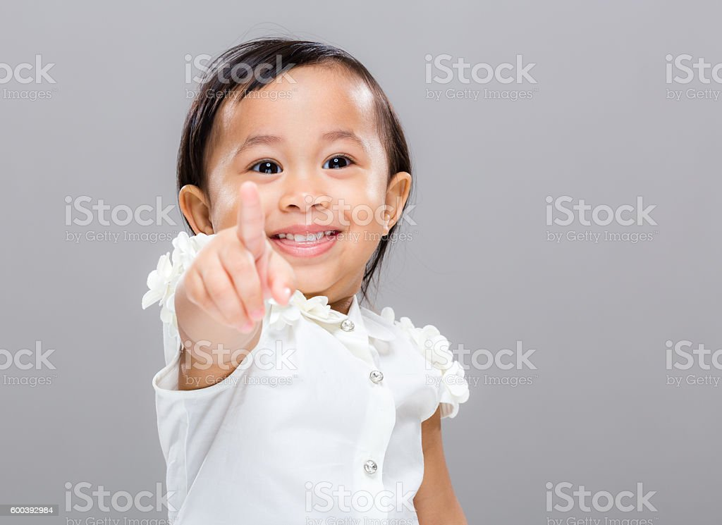 Happy toddler pointing stock photo