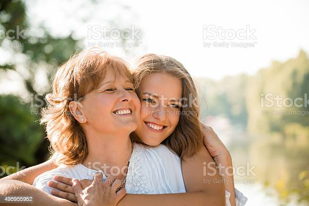 Happy together mother and teenage daughter outdoor picture id495955952?b=1&k=6&m=495955952&s=612x612&h=1jzgcgyhcvap03d ng0lhfxqes7ugz5d0ycispbxngy=