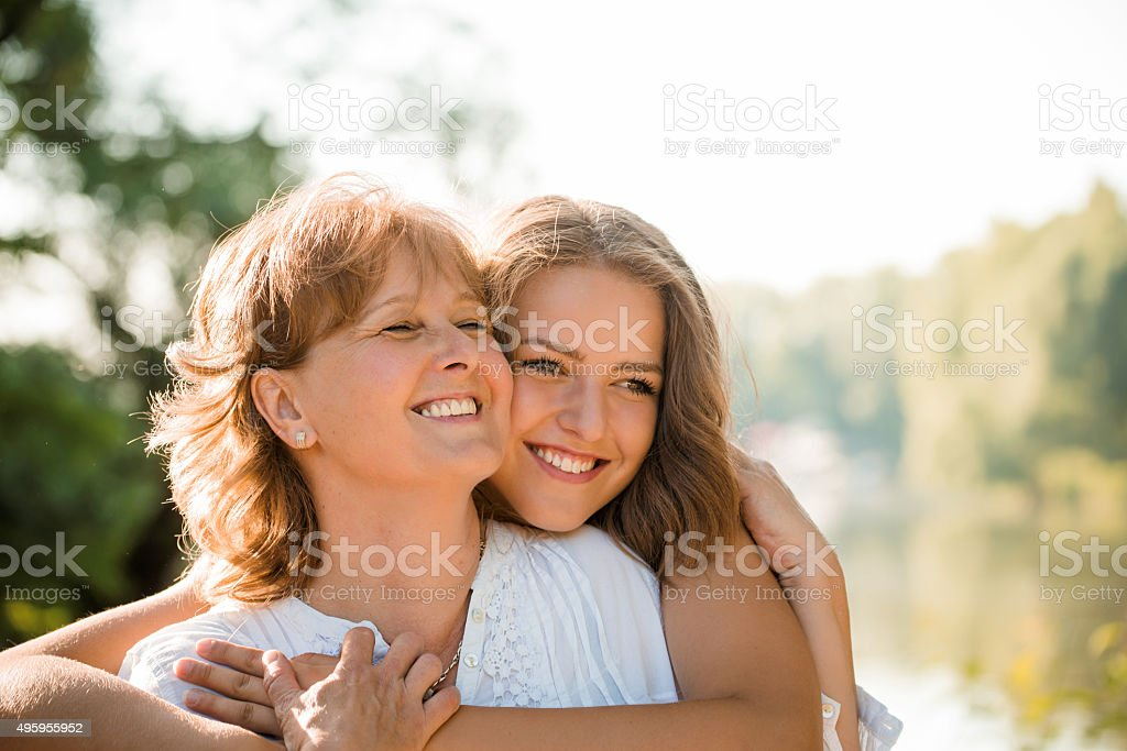 Happy together - mother and teenage daughter outdoor stock photo