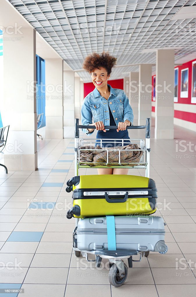 Happy tourist at the airport royalty-free stock photo