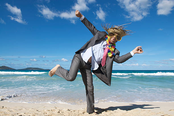 Happy Tourist Businessman Dancing Crazy on the Beach stock photo
