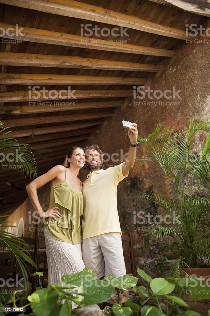 Happy tourist couple taking a picture royalty-free stock photo