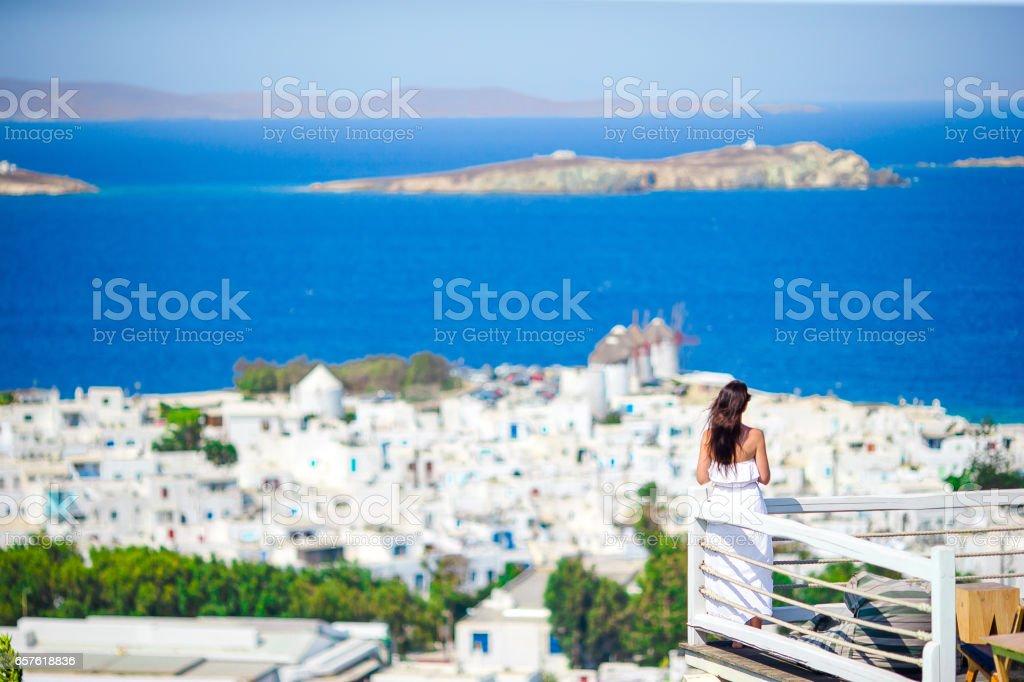 Happy tourist woman enjoy amazing view on Mykonos, Greece stock photo