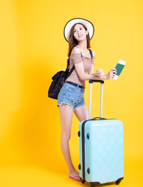 Happy tourist woman in summer hat with passport and suitcase picture id1138153477?b=1&k=6&m=1138153477&s=612x612&w=0&h=vzuwpxnllmlogsejwtkgoh 0etkttvimf4p2y ajz2c=