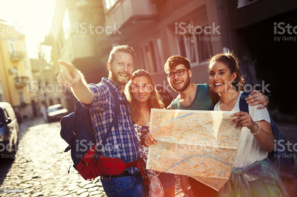 Happy tourists exploring city stock photo