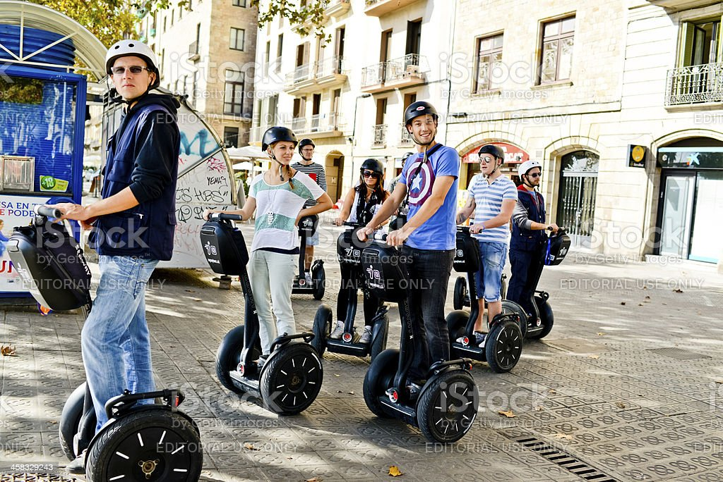Happy Tourists on Segway tour in Barcelona, Spain stock photo