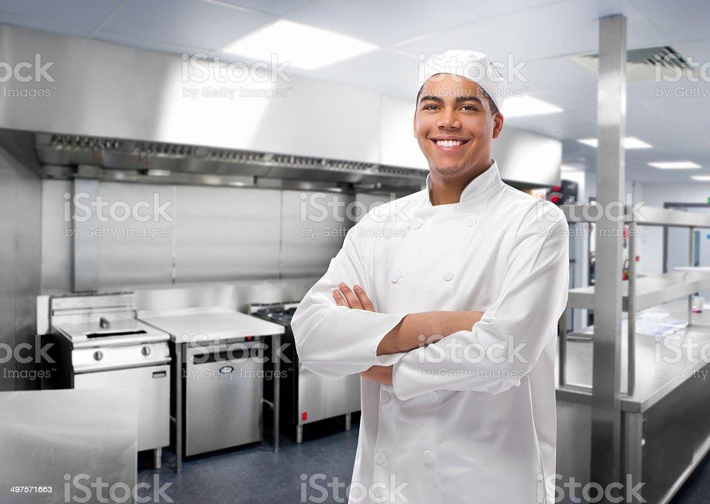 happy trainee chef in modern kitchen stock photo
