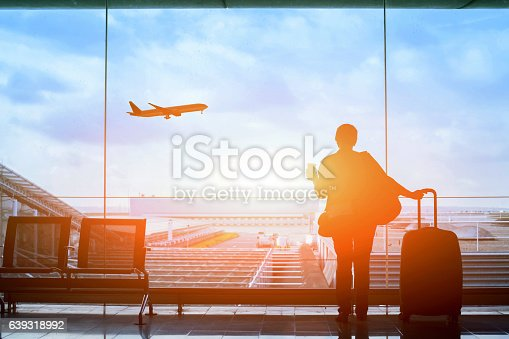 happy traveler waiting for the flight in airport, departure terminal, immigration concept