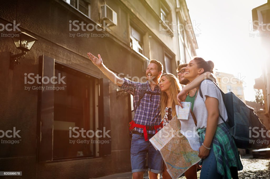 Happy traveling tourists sightseeing stock photo